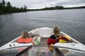 Lake Of The Woods, Ontario, Canada. Girls Sitting In Front Of Boat — Foto de Stock