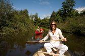 People in canoe — Stock Photo