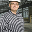 Man In Hardhat In Partially Built Building — Stock Photo