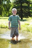 Boy Standing In The Water — Stock Photo