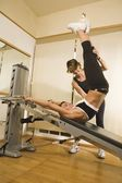 Young Woman With Personal Trainer — Stock Photo