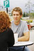 Man Looking At Woman At Outdoor Cafe — Stock Photo