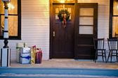 Christmas Gifts Outside The Front Door — Stock Photo
