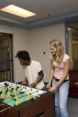 Teenagers Playing Foosball — Stock Photo