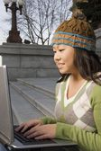 Girl Working On Computer Outside — Stock Photo