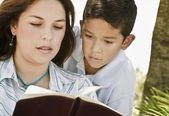 Mother And Son Reading A Bible — Stock Photo