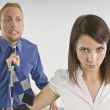 Woman Pulling Man By His Necktie — Stock Photo