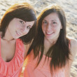 Two Young Women Sitting On The Beach — Stock Photo