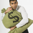 Man Clutching A Bag Of Money — Stock Photo