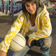 Teenage Girl Crouched With A Basketball — Stock Photo