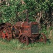 Stock Photo: Old Rusted Tractor In Field