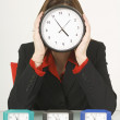 Businesswoman Holding A Clock In Front Of Her Face — Stock Photo