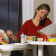 Young Mother Working From Home — Stock Photo #31933967