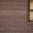 Red Brick Wall With A Boarded Up Window — Stock Photo
