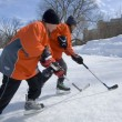 Stock Photo: Boys Playing Ice Hockey On Outdoor Rink
