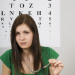 Woman Sitting In Front Of Eye Chart — Stock Photo