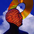Stock Photo: Silhouette Of MWith Binary Numbers And Cd Rom