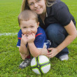 Young Soccer Player And His Mother — Stock Photo