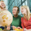 College Students In Study Hall With A Desk Globe — Stock Photo