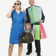 Man Holding Woman's Shopping Bags — ストック写真