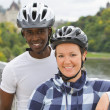 Cyclists With The Parliament Buildings In The Background — Foto Stock