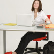 Stock Photo: Businesswoman Working At Desk