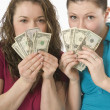 Two Women Holding Money In Front Of Their Faces — Stock Photo #31935085