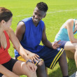 Athletes Relaxing On A Bench — Stock Photo