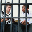 Young Man Reads The Bible To Another Young Man In Jail — Stock Photo #31935391