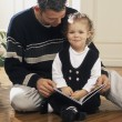 Father Reading A Book With Daughter — Foto Stock