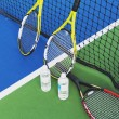 Three Tennis Rackets On A Tennis Court — Stock Photo