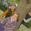 Three Young Children By Tree Outdoors — Stock Photo
