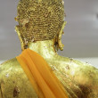 Golden Buddha Statue With Orange Sash — Stock Photo