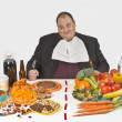 Stock Photo: Overweight MSitting At Table Full Of Food
