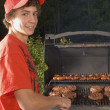 Teenage Boy Barbequing Hamburgers — Stock Photo