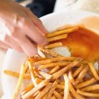 Eating French Fries With Gravy — 图库照片