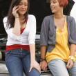 Two Women Leaning On Hood Of Car — Stock Photo