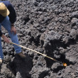 MWith Stick Pointed At Lava — Stock Photo #31936495