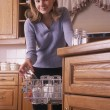 Stock Photo: Girl Loading Dishwasher