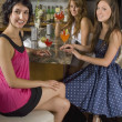 Three Girl Friends Sitting At A Cocktail Bar With Cocktails — Stock Photo