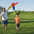 Father And Son At The Park With A Kite — Stock Photo