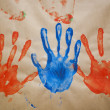 Handprints Made With Paint On Brown Paper — Stock Photo
