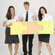 Three People Putting Puzzle Pieces Together — Stock Photo