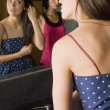 Two Young Women Looking At Themselves In A Bathroom Mirror — Stock Photo #31937391