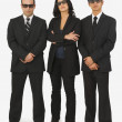 Three People Dressed In Black Suits — Stock Photo