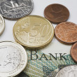 American And Euro Coins On Top Of A Foreign Currency Bank Note — Stock Photo