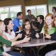 Group Of Friends Visiting In Restaurant — Stock Photo