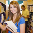 Stock Photo: Young WomIn Library