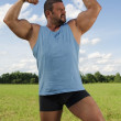 Stock Photo: Bodybuilder Outdoors Flexing