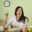Stock Photo: Teacher Sitting At Desk